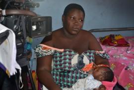 A survivor of pregnancy complication being interviewed